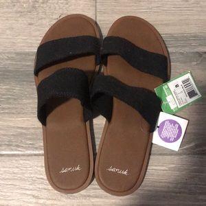 Never worn sanuk sandals